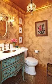 country french style interior powder room with golden ceiling and