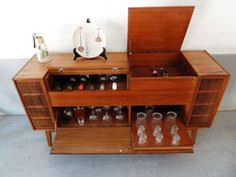 wine cabinet made from a vintage stereo cabinet found at fresh