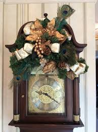 front hall grandfather clock decorated for christmas includes gold