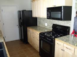 black kitchen cabinets with white appliances video and photos