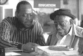 Literacy Instructor, Carl Henry and George Dawson reading.