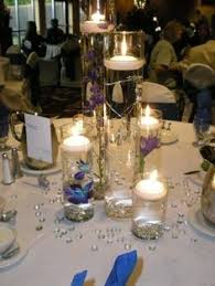 Purple Floating Candles For Centerpieces by Cylindrical Centerpiece Purple Dendrobium Orchid Floating