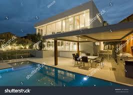 modern backyard swimming pool mansion stock photo 107189060