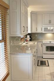 white painted kitchen with black island village home stores