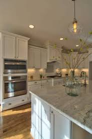 off white cabinets off white cabinets and wood custom island in a
