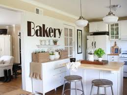 kitchen wicker basket cups plates sink faucet white cabinet