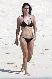 Courteney Cox shows she still has a killer bod on the beach in Turks and Caicos