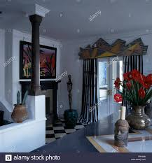 painted wooden carving above french doors with black white