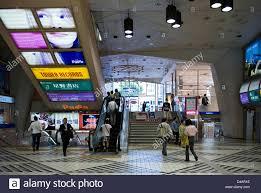 illuminated advertising panels on the ceiling inside nagoya train