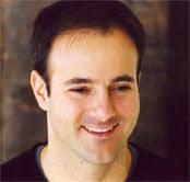 Headshot of Andrew Levine, smiling. - biopic