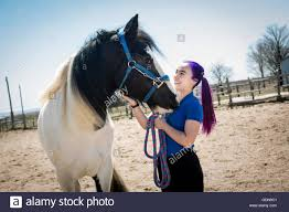 beautiful teen on the farm with her horse stock photo