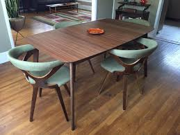 mix and match is the modern way to furnish a dining room the