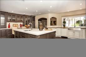white glass tile backsplash apron front sinks white countertops