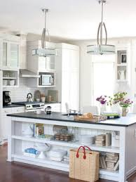 white island with 2 layers shelves white kitchen cabinets black