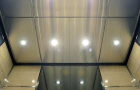 pan formed stainless steel panels extrude from a suspended drop