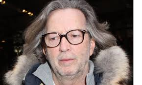 North Korea asked America to arrange an Eric Clapton concert in Pyongyang, saying that it could help to persuade Kim Jong-il to allow humanitarian aid into ... - Eric-Clapton-in-New-York--006