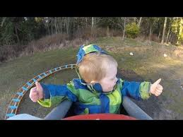 kid rides homemade backyard roller coaster for first time