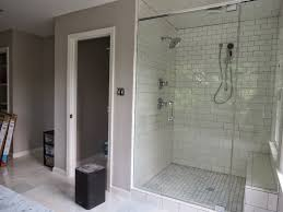 bathroom cozy shower bench with white merola tile wall and rain