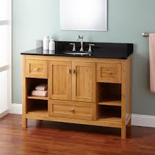 light brown stained oak wood narrow bathroom vanity cabinet with