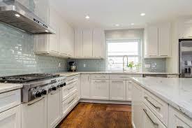 100 white kitchen cabinets with granite kitchen backsplash