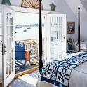 Deep-Blue Beach Bedroom < 10 Beautiful Beach Cottages - Coastal Living