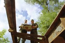 Harry Kantola and Russian Maj. Ivan Parfenov talk about the plans of rebuilding the bridge. - b01p151a