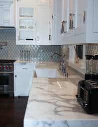 bluish grayish moroccan style tiles for the backsplash with bluish grayish moroccan style tiles for the backsplash with calcutta marble countertops by mesa designs