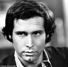 chevy black friday commercial actors chevy chase 71 shows off a wider tummy as he lights a cigarette