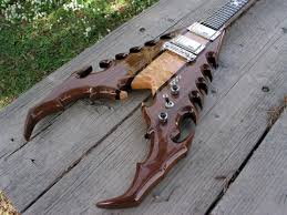 "Electra ""Lady"" on Ebay, strange guitar! Images?q=tbn:ANd9GcQNwIXMyt5u7JmKj-7Y4g1wAsKBu63jTDz43ItXRDHFB_KIemhv&t=1"