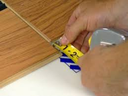 Laminate Flooring No Transitions How To Install Underlayment And Laminate Flooring How Tos Diy