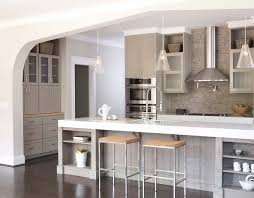 kitchen with thick corian counters and light lime washed oak kitchen with thick corian counters and light lime washed oak cabinets stacked stone backsplash and