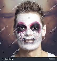 portrait man halloween skull makeup halloween stock photo