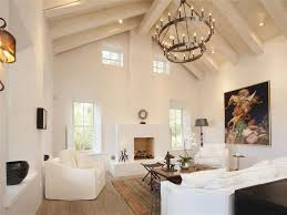 Exposed Beam Ceiling Living Room by Cottage Living Room Cement Fireplace Zillow Digs Zillow