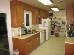 kitchen brown kitchen cabinets stainless faucet electric stove