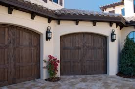 our faux wood carriage house style garage doors add curb appeal to