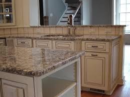dove white cabinets with taupe glaze gallo napoleone granite