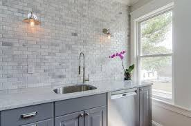 Brick Tiles For Backsplash In Kitchen by White Kitchen With Mini Brick Marble Tiles And Clear Glass