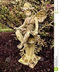 fairy statue on pillar in garden stock photo image 42080621
