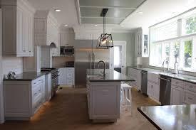 mosaic tiles for backsplashes light gray kitchen cabinets black