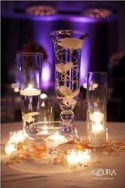 Purple Floating Candles For Centerpieces by Rent Tall Pilsner Vases Fill With Water And Floating Candle For