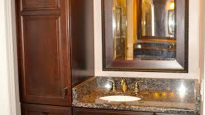 cherry finish bathroom cabinets with granite countertop vaughn