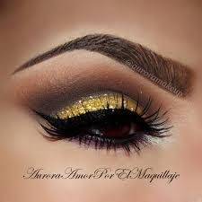 gold glitter smokey cut crease with dramatic winged liner gorge