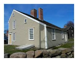 architectural styles saltbox house with a slanted roof and has 1