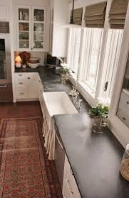 best 25 kitchen countertops ideas on pinterest kitchen counters i get a lot of questions asking about my experience with the soapstone countertops in the