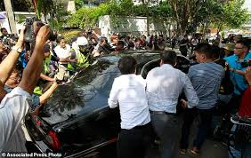 The Latest  Malaysia PM  N  Korea holding citizens      hostage     Daily Mail Journalists surround a car of North Korean Ambassador to Malaysia Kang Chol leaving the embassy in