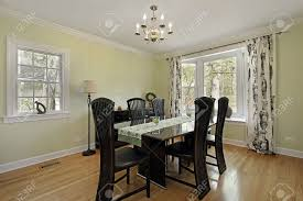 dining room in suburban home with light green walls stock photo