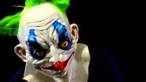 wide eyed killer clown latex halloween mask on a minions head