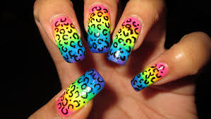 try out this wild and colorful acid leopard nail art design