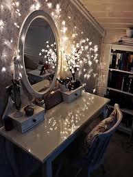 glass top dressing table lighted mirror decorated with wall string