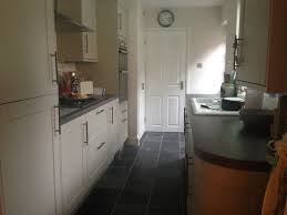 finished kitchen howdens burford grey kitchen units rough slate finished kitchen howdens burford grey kitchen units rough slate tiled floor metro wall tiles with grey grout what a difference a year makes